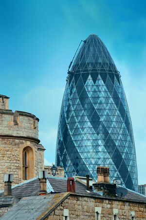 conducted: LONDON, UK - SEP 27: Group of financial district office buildings on September 27, 2013 in London, UK. London is the worlds greatest foreign exchange market with major trade conducted in district