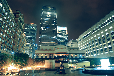 LONDON, UK - SEP 27: Canary Wharf at night on September 27, 2013 in London, UK. It is one of Londons two main financial centres with 14M sqr ft of office and retail space.