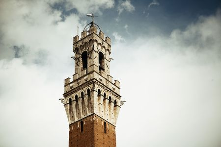 the renaissance: City Hall Bell Tower closeup in Siena Italy.