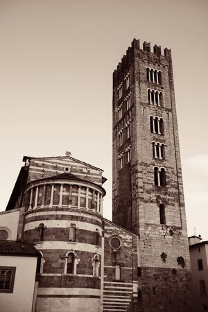 lucca: Basilica di San Frediano in Lucca with historic buildings in Italy.