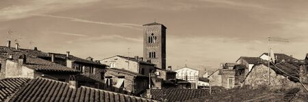 blackwhite: Tower of Chiesa San Pietro with roofs of historic buildings panorama view in Lucca, Italy.