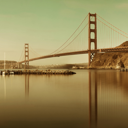 steel tower: Golden Gate Bridge in San Francisco as the famous landmark with reflections.