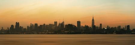 city of sunrise: New York City skyscrapers silhouette urban view at sunrise. Stock Photo