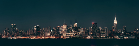 Midtown Manhattan skyline at dusk panorama over Hudson River Stock Photo