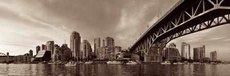 blackwhite: Vancouver False Creek panorama at sunset with bridge and boat. Stock Photo