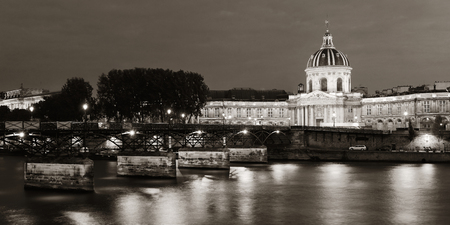 River Seine with Pont des Arts and Institut de France panorama at night in Paris, France. Stock Photo