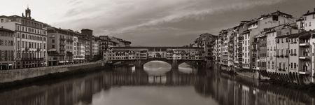 blackwhite: Ponte Vecchio over Arno River panorama in Florence Italy black and white.