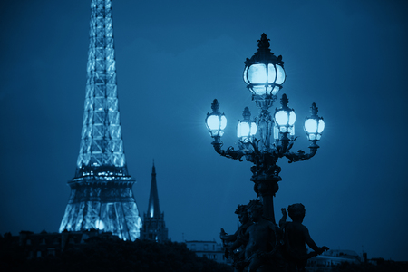 PARIS, FRANCE - MAY 13: Eiffel Tower and vintage lamp at night on May 13, 2015 in Paris. With the population of 2M, Paris is the capital and most-populous city of France Stock Photo