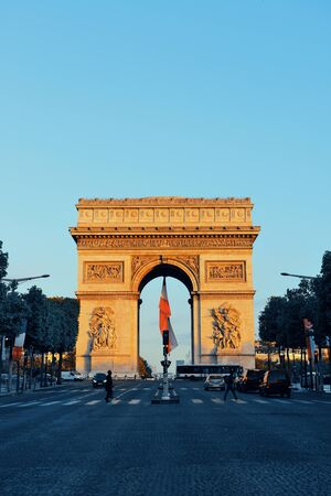 traffic building: PARIS, FRANCE - MAY 13: Arc de Triomphe and street view on May 13, 2015 in Paris. With the population of 2M, Paris is the capital and most-populous city of France Stock Photo