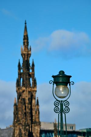 Scott Monument, vintage lamp and Edinburgh city view in United Kingdom. Stock Photo