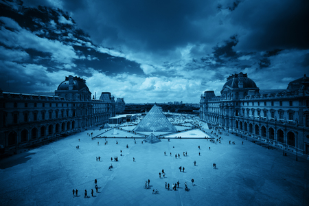blackwhite: PARIS, FRANCE - MAY 13: Louvre closeup exterior view on May 13, 2015 in Paris. With over 60k sqM of exhibition space, Louvre is the biggest Museum in Paris. Editorial