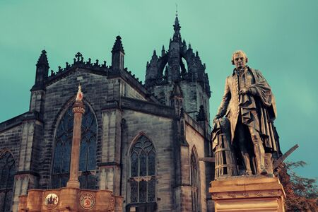 giles: St Giles Cathedral with Duke of Buccleuch (Walter Scott) statue as the famous landmark of Edinburgh. United Kingdom.
