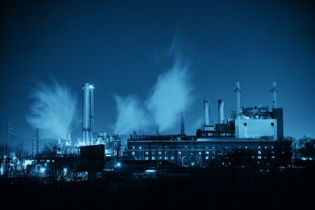 industry architecture: Factory with chimney at night in Philadelphia. Stock Photo