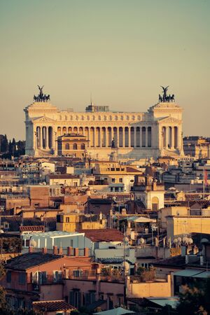 Rome rooftop view with Monumento Nazionale a Vittorio Emanuele II in Italy at sunset.