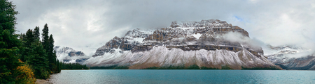 Bow Lake panorama with snow capped mountain and forest in Banff National Park Stock Photo