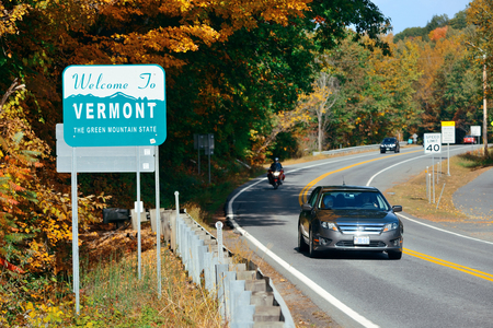VERMONT - OCT 11: Welcome sign and road traffic on October 11, 2015 in Vermont. Forests cover approximately 75% of its total land area, Vermont is the 2nd least populous in US. Editöryel
