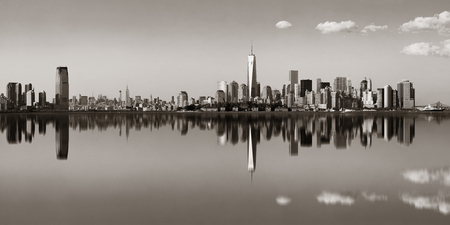 blackwhite: Manhattan downtown skyline with urban skyscrapers over river with reflections. Stock Photo