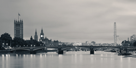 Thames River panorama with London Eye and Westminster Palace in black and white in London. Stock Photo