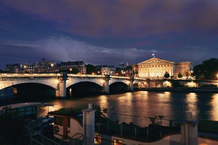 Paris River Seine with Pont de la Concorde and Assemblee Nationale at dusk Stock Photo