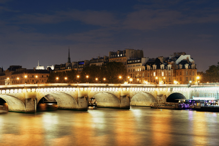 River Seine and Pont Neuf at night in Paris, France. Stock Photo