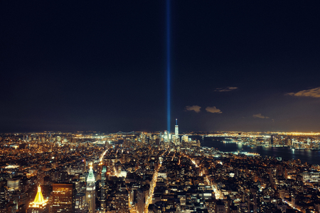 New York City downtown skyline view at night with September 11 tribute light. Stock Photo
