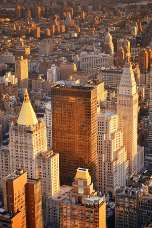 fifth avenue: New York City historical skyscrapers and urban cityscape at sunset. Stock Photo
