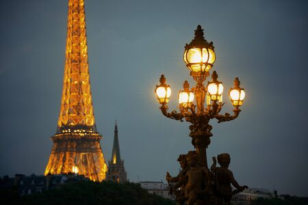 PARIS, FRANCE - MAY 13: Eiffel Tower and vintage lamp at night on May 13, 2015 in Paris. With the population of 2M, Paris is the capital and most-populous city of France Editorial