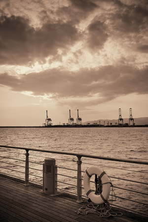Osaka seaport with crane silhouette at sunset. Japan. Stock Photo