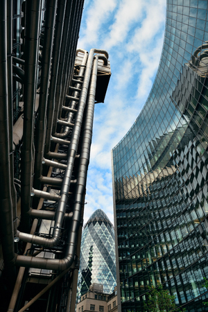willis: LONDON, UK - SEP 27: Financial district office buildings in street on September 27, 2013 in London, UK. London is the worlds greatest foreign exchange market with major trade conducted in the district.