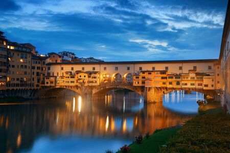 Ponte Vecchio over Arno River at night in Florence Italy. Stock Photo