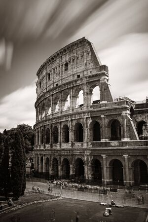 amphitheatre: Colosseum closeup view with long exposure, the world known landmark and the symbol of Rome, Italy.