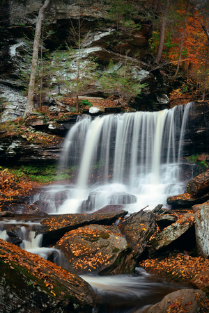 pa: Autumn waterfalls in park with colorful foliage.