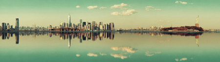 Manhattan downtown skyline with urban skyscrapers over river with reflections. Stok Fotoğraf
