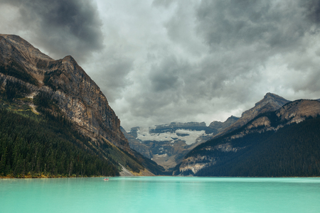 Lake Louise in Banff national park with mountains and forest in Canada. Stock Photo