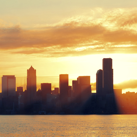 wa: Seattle sunrise skyline silhouette view with urban office buildings. Stock Photo