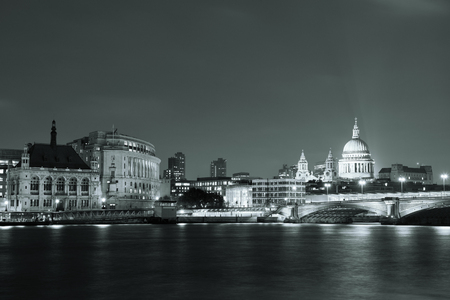 blackwhite: London skyline at night with bridge and St Pauls Cathedral over Thames River. Stock Photo
