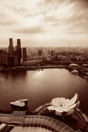 blackwhite: Singapore rooftop view of Marina Bay with urban skyscrapers at sunset.
