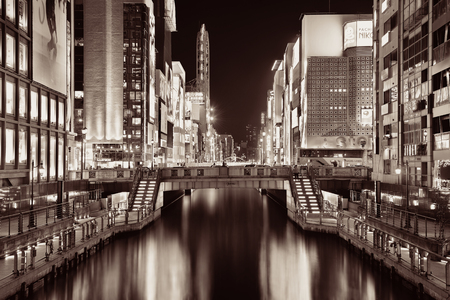 OSAKA, JAPAN - MAY 11: Dotonbori business street at night on May 11, 2013 in Osaka. With nearly 19 million inhabitants, Osaka is the second largest metropolitan area in Japan after Tokyo. Editorial
