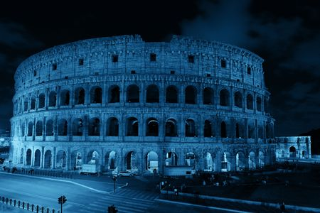 blackwhite: Colosseum at night with light trail in Rome, Italy.
