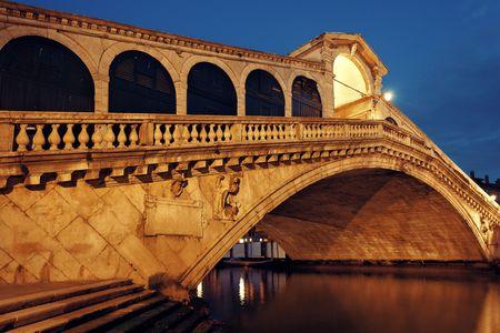 Rialto Bridge or Ponte di Rialto over Grand Canal at night in Venice, Italy. Stock Photo