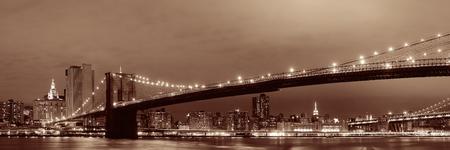 blackwhite: Manhattan Downtown urban view with Brooklyn bridge at night Stock Photo