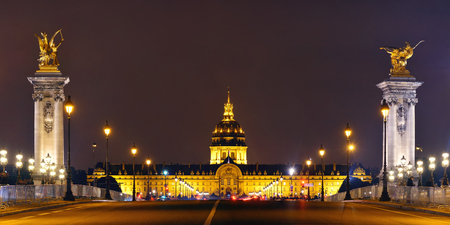 Alexandre III bridge night view panorama with Napoleons tomb in Paris, France.