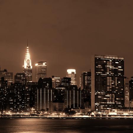Midtown Manhattan skyline at dusk panorama over East River Stock Photo