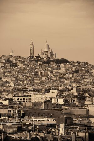 sacre coeur: Paris rooftop view of the city skyline and Sacre Coeur in France.