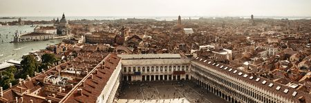 Rooftop panorama view from the bell tower of historical buildings at Piazza San Marco in Venice, Italy. Stock Photo