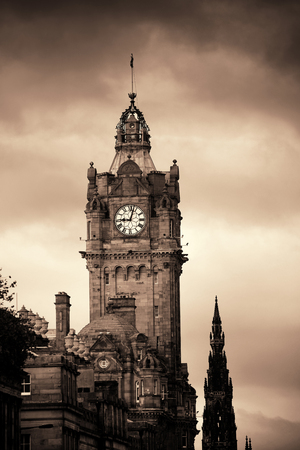 Balmoral Hotel bell tower with Scott Monument and Edinburgh city view. Stock Photo