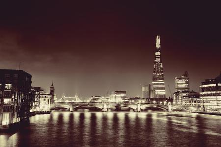 shard: Southwark Bridge and London skyline at night.