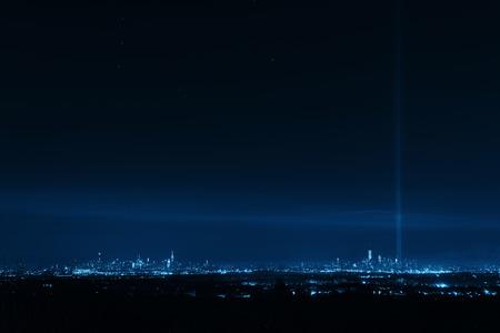 New York City skyline at night and September 11 tribute light Stock Photo
