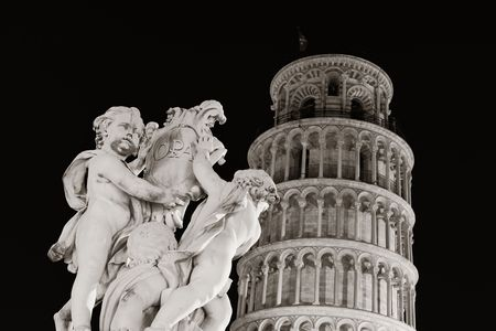 angels fountain: Leaning tower and fountain sculpture at night in Pisa, Italy as the worldwide known landmark.