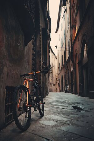 Lucca street view with bike in Italy Stock Photo